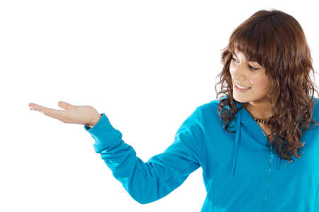 Girl holding nothing over a white background photo