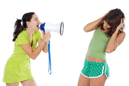 Teen Girl with megaphone  shouting to another girl photo