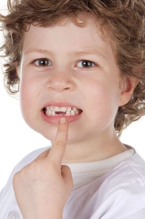 Cute toothless boy pointing with his finger Stock Photo