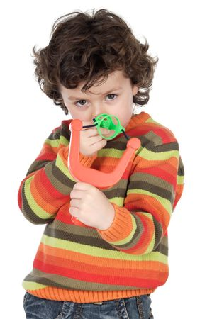 prankster: Cute naughty boy aiming with a slingshot Stock Photo