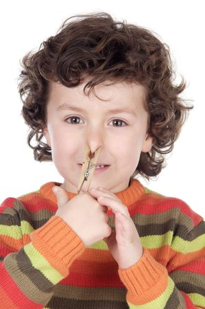 Adorable kid with a clothespin in his nose