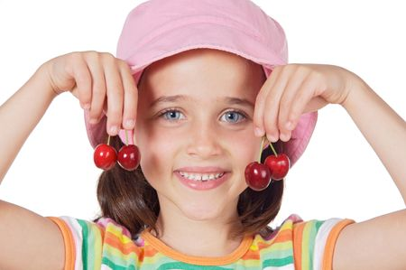 Cute girl with fresh cherries isolated on white photo