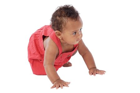 adorable baby crawling wearing a red dress Stock Photo