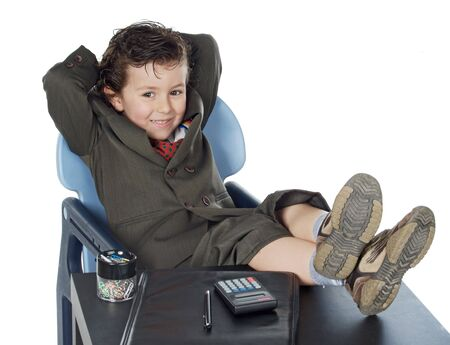 Lovely boy in a suit with his feet on the table Stock Photo - 2043487
