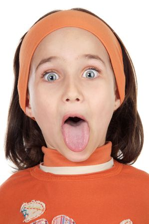 Cute girl sticking out her tongue over white background Stock Photo