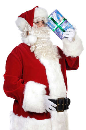 Santa Claus trying to remember over white background photo