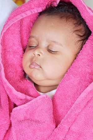 adorable sleepy girl a over pink  background photo