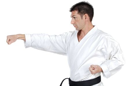 karateka: Black belt karate expert with fight stance Stock Photo