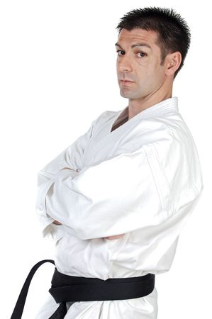 karateka: Black belt karate expert over white background Stock Photo