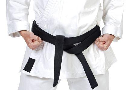 black belt: Black belt karate expert with rest position