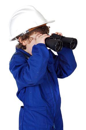 Little boy with helmet, binoculars and coveralls photo
