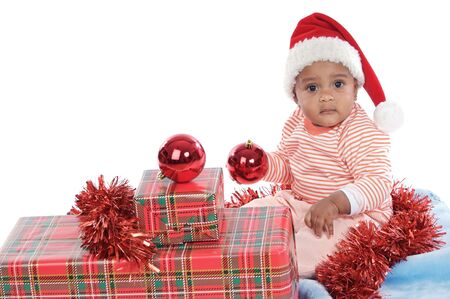 Adorable  girl with christmas presents and santa hat Stock Photo - 2147296