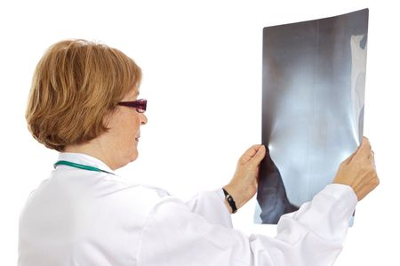 Doctor looking to x-ray picture over white background photo