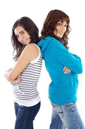 Pretty girls back to back over white background Stock Photo