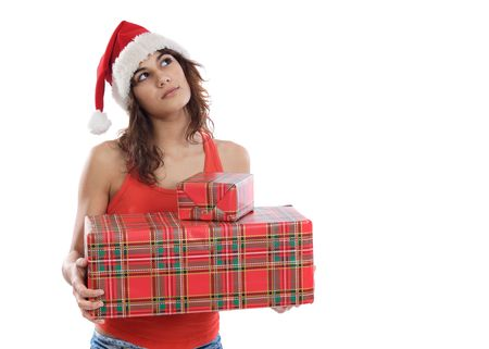 Pretty girl with christmas boxes and thoughtful expression photo