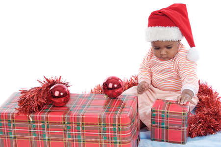 Adorable baby girl with christmas presents and santa hat Stock Photo - 2214458