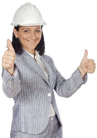 Worker woman with helmet and thumbs up photo