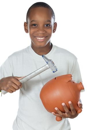 Boy with a hammer breaking a money box photo