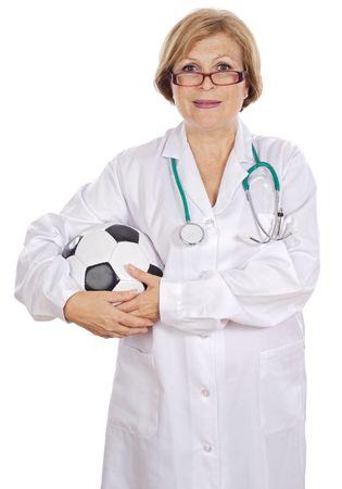 Female doctor holding soccer ball over white background photo