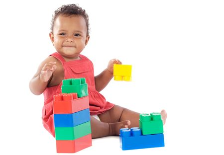 girl playing with building blocks over white background photo