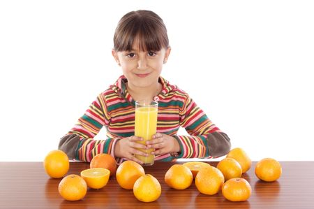 Cute girl with oranges and juice a over white background photo