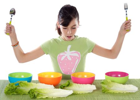 Cute young girl with lettuce and colourful bowls Stock Photo - 2236177