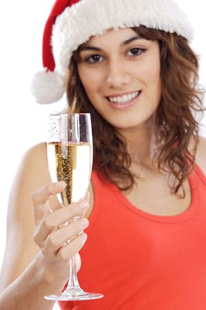 Pretty santa girl holding a glass of champagne - focus in a glass - photo