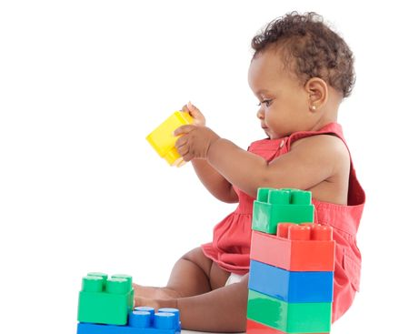 Adorable  girl playing with building blocks photo