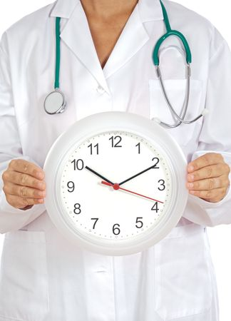 show time: Doctor�s hands showing clock over white background