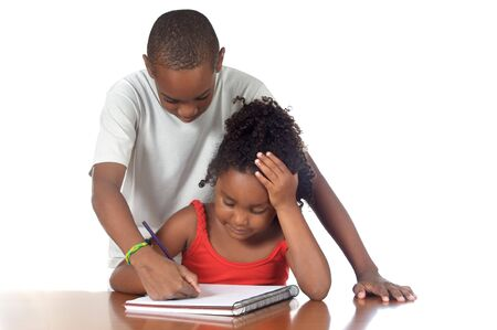 studing: A couple of kids studing together over white background