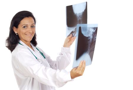 Female doctor looking to x-ray picture over white background photo