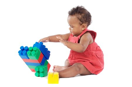 Adorable baby girl playing with building blocks photo
