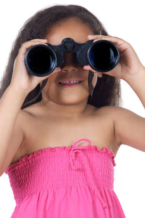 educating: girl looking throuth the binoculars a over white background
