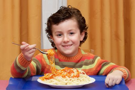 eating noodles: Adorable child eating  - focus in the face -