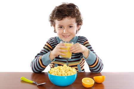 Niños comiendo el desayuno más de un fondo blanco  Foto de archivo - 2472291