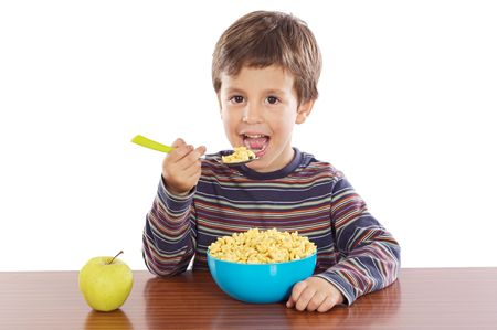 over eating: Child eating breakfast a over white background