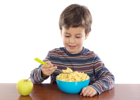 Adorable child breakfasting a over white background photo