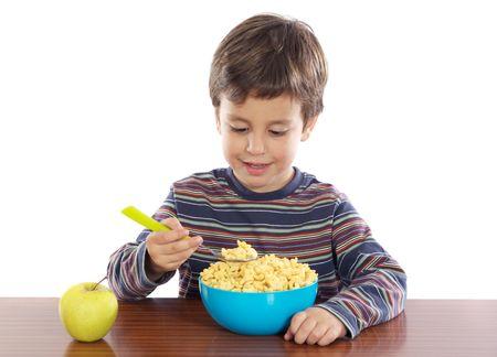 Adorable niño desayunando en un fondo blanco  Foto de archivo - 2514207