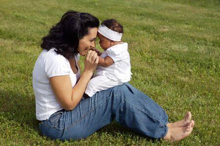 Mother playing with her daughter on the grass Stock Photo - 2514232
