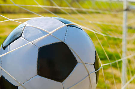 Photo of a ball inside the goal  photo