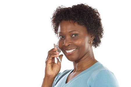 Attractive African-American woman talking on the telephone photo