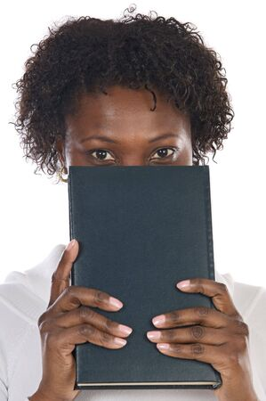 African american woman with book in her face photo