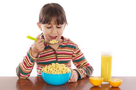 ni�os desayuno: Chica de comer un desayuno m�s de fondo blanco