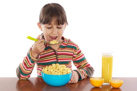 Girl eating breakfast a over white background photo