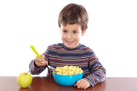 Child eating breakfast a over white background photo