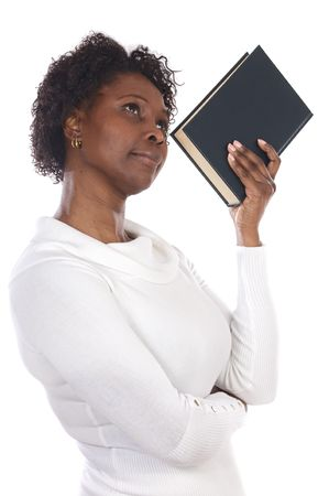 Thinking attractive woman with a book a over white background photo