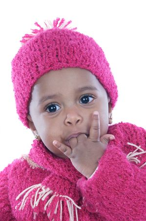 Baby with his finger in the mouth a over white background