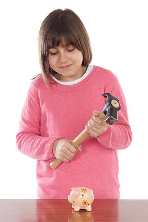 Adorable girl  with hammer and money box a over white background Stock Photo - 2682911