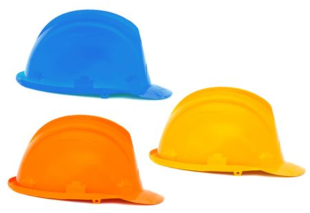 Three helmets a over white background , blue, orange, yellow Stock Photo - 2712443