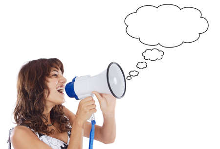 agitation: Teenager speaking through a megaphone over white background Stock Photo